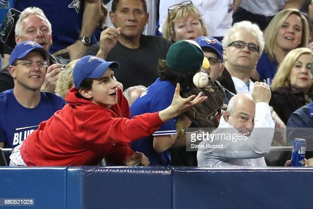TORONTO MAY 8 A fan catches a ball as the Toronto Blue Jays beat the Cleveland Indians 42 at Rogers Centre in Toronto May 8 2017