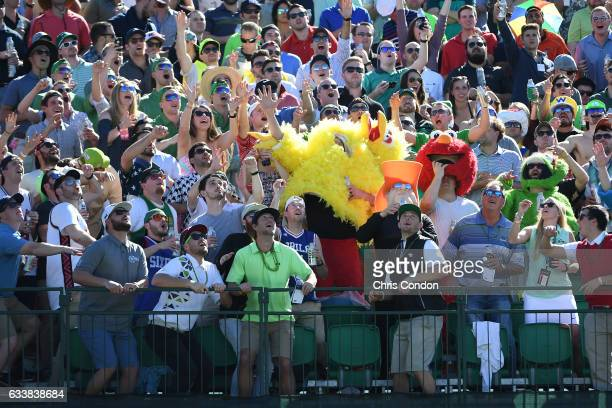 A fan catches a ball at the 16th hole during the third round of the Waste Management Phoenix Open at TPC Scottsdale on February 4 2017 in Scottsdale...