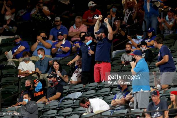 A fan catches a foul ball during the second inning in Game One of the National League Championship Series between the Los Angeles Dodgers and the...