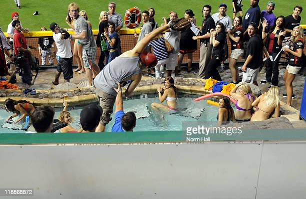 Fan catches a home run ball in the pool during the 2011 State Farm Home Run Derby at Chase Field on July 11, 2011 in Phoenix, Arizona.
