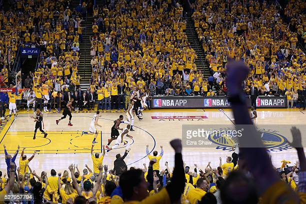 Fan celebrate after Harrison Barnes of the Golden State Warriors made a threepoint basket against the Portland Trail Blazers during Game Two of the...