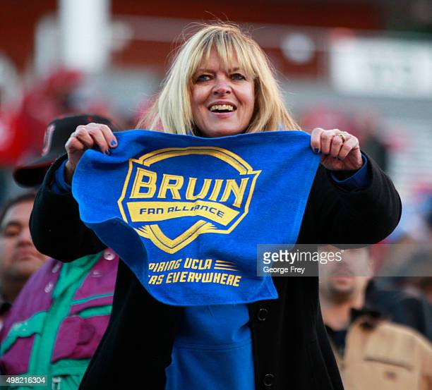 UCLA fan celebrates after the Bruins beat the Utah Utes during the second half of a college football game at Rice Eccles Stadium on November 21 2015...