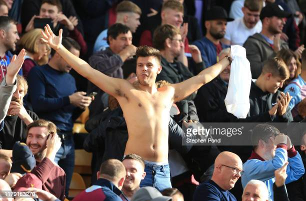 Fan celebrates during the Premier League match between Norwich City and Aston Villa at Carrow Road on October 05, 2019 in Norwich, United Kingdom.