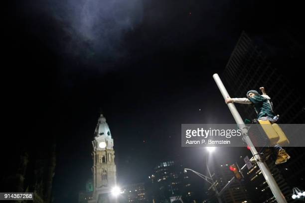 A fan celebrates in Center City after the Philadelphia Eagles defeated the New England Patriots to win the Super Bowl on February 4 2018 in...