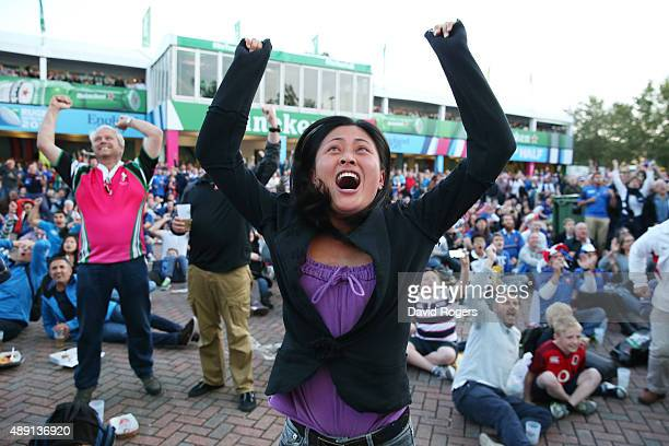 A fan celebrates the Japan victory over Japan before watching the 2015 Rugby World Cup Pool D match between France and Italy at Twickenham Stadium on...