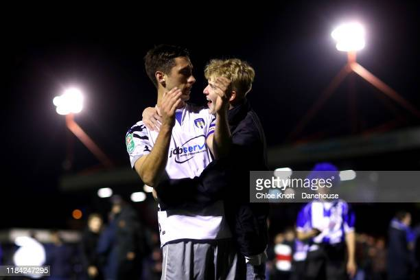 Fan celebrates with Luke Prosser of Colchester United after the Carabao Cup Round of 16 match between Crawley Town and Colchester United FC at The...