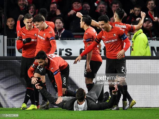 Fan celebrates with the Renns players after the 3rd goal during the UEFA Europa League Round of 16 First Leg match between Stade Rennais and Arsenal...