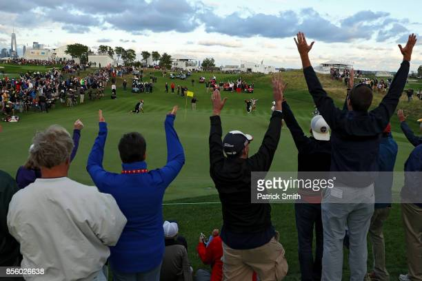 Fan cheer after Charlie Hoffman of the US Team celebrates after chipping in on the 17th hole during Saturday fourball matches of the Presidents Cup...