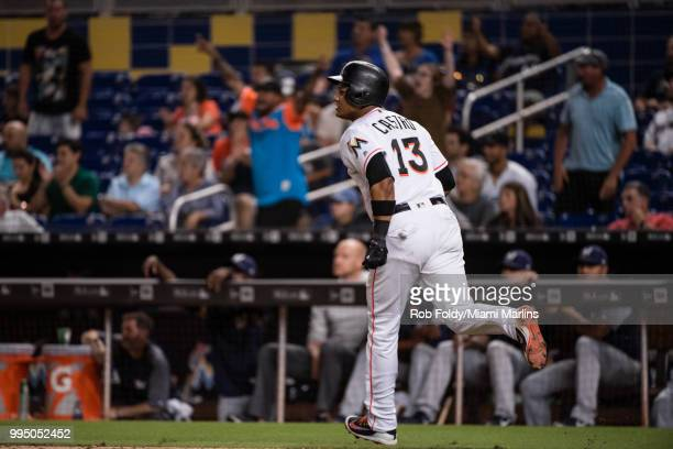 Fan cheer as Starlin Castro of the Miami Marlins hits a home run during the game against the Milwaukee Brewers at Marlins Park on July 9 2018 in...