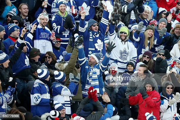 TORONTO ON JANUARY 1 A fan cheers after catching a puck as the Toronto Maple Leafs beat the Detroit Red Wings 54 in overtime the Centennial Classic...