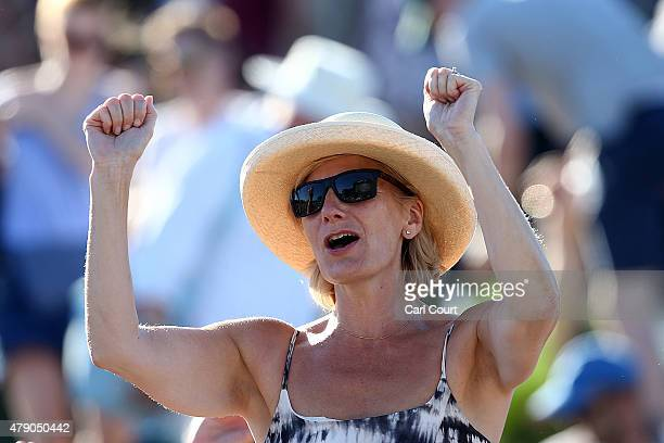 A fan cheers as Andy Murray of Great Britain beats Mikhail Kukushkin of Kazakhstan in their gentlemen's first round singles match on day two of...