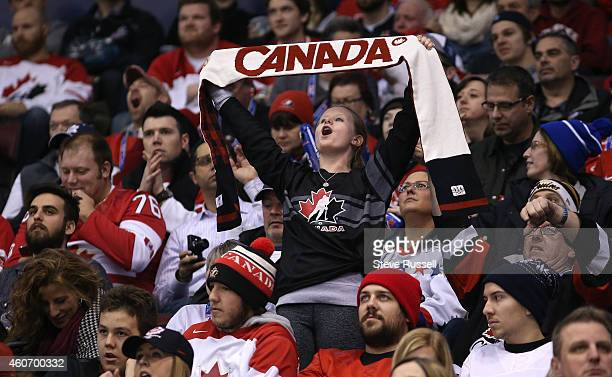 TORONTO ON DECEMBER 19 A fan cheers as Team Canada out shoots Team Russia 5320 but loses 21 in overtime in a 2015 IIHF World Junior Championship...