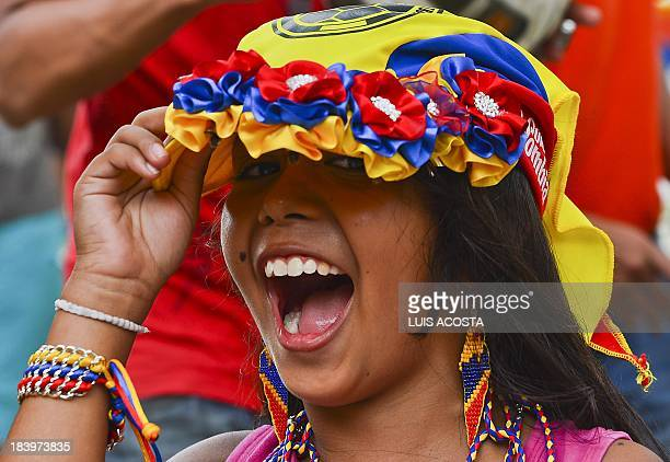 A fan cheers as the Colombian national football team arrives for a training session in Barranquilla Colombia on October 10 2013 Colombia will face...