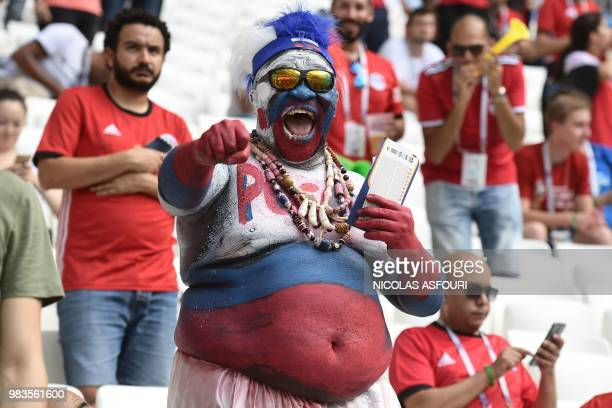 A fan cheers before the start of the Russia 2018 World Cup Group A football match between Saudi Arabia and Egypt at the Volgograd Arena in Volgograd...