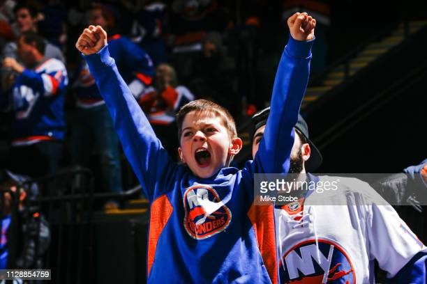 Fan cheers during the game between the New York Islanders and the Toronto Maple Leafs at NYCB Live's Nassau Coliseum on February 28, 2019 in...