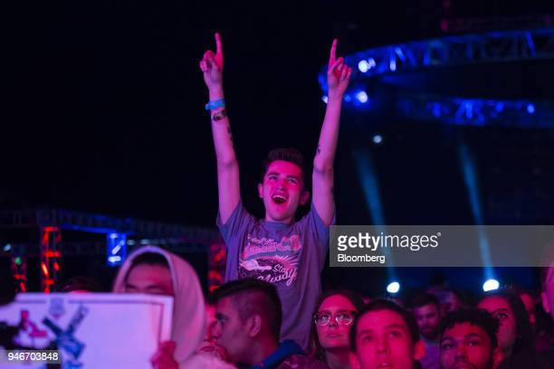 A fan cheers during the Halo World Championship finals in Seattle Washington US on Sunday April 15 2018 Esports revenue consisting of merchandise...