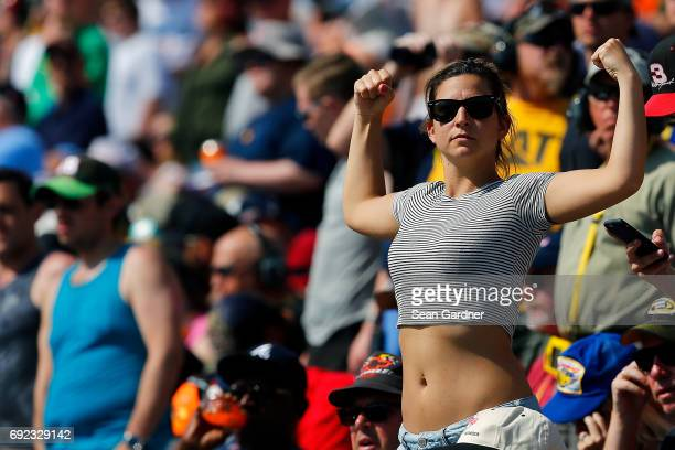 A fan cheers during the Monster Energy NASCAR Cup Series AAA 400 Drive for Autism at Dover International Speedway on June 4 2017 in Dover Delaware