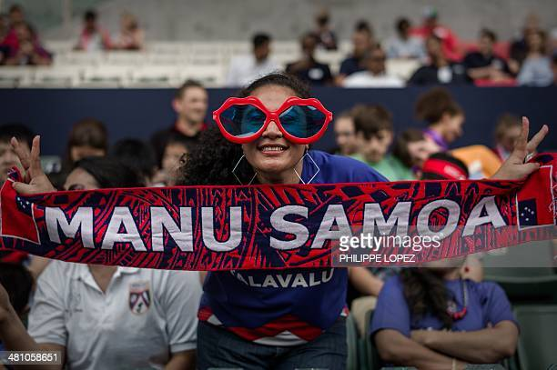 A fan cheers for her team at the rugby sevens tournament in Hong Kong on March 28 2014 Fiji will be looking to turn up the heat on mighty New Zealand...