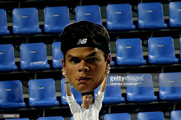 A fan cheers for Milos Raonic of Canada as he plays Fernando Verdasco of Spain during the Shanghai Rolex Masters at the Qi Zhong Tennis Center on...