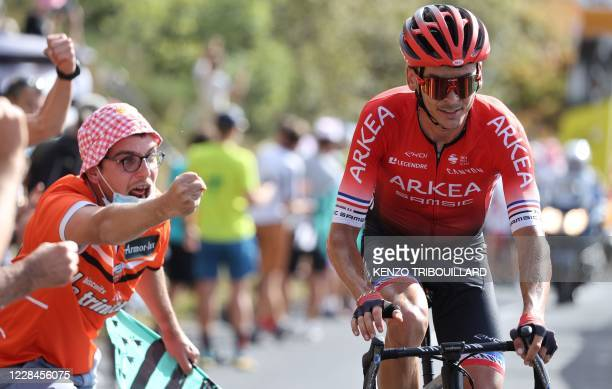 A fan cheers for Team Arkea Samsic rider France's Warren Barguil during the 13th stage of the 107th edition of the Tour de France cycling race 191 km...