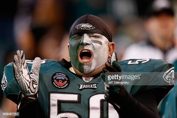 A fan cheers for the Philadelphia Eagles during the second half of the game against the Tennessee Titans at Lincoln Financial Field on November 23...