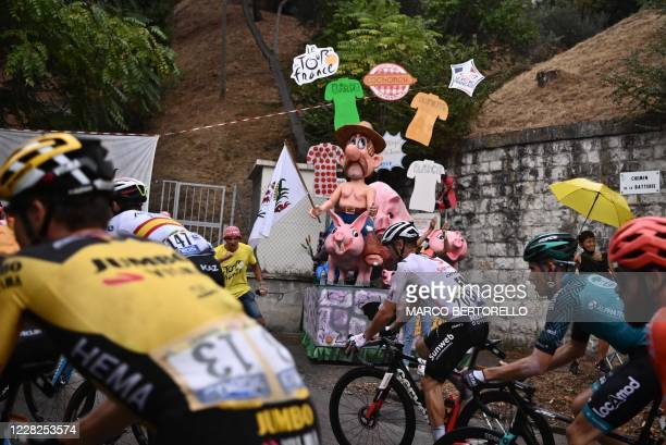 A fan cheers for the riders during the 1st stage of the 107th edition of the Tour de France cycling race 156 km between Nice and Nice on August 29...