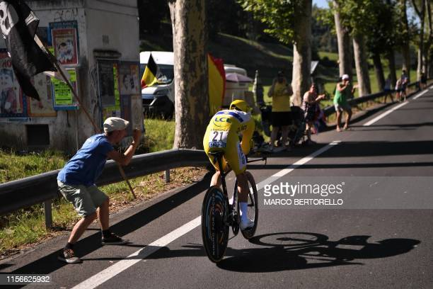 A fan cheers France's Julian Alaphilippe wearing the overall leader's yellow jersey during the thirteenth stage of the 106th edition of the Tour de...