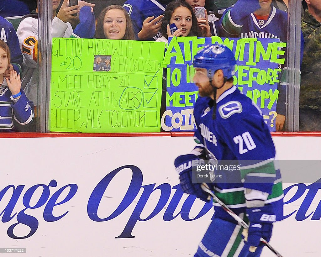 A fan cheers on Chris Higgins #20 of the Vancouver Canucks before the game against the Nashville Predators at Rogers Arena on March 14, 2013 in Vancouver, British Columbia, Canada. The Vancouver Canucks won 7-4.