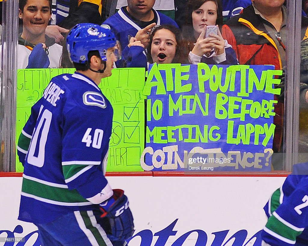 A fan cheers on Maxim Lapierre #40 of the Vancouver Canucks before the game against the Nashville Predators at Rogers Arena on March 14, 2013 in Vancouver, British Columbia, Canada. The Vancouver Canucks won 7-4.
