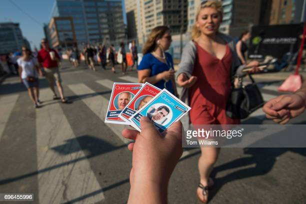 A fan collects baseball cards before the 56th Congressional Baseball Game at Nationals Park on June 15 2017