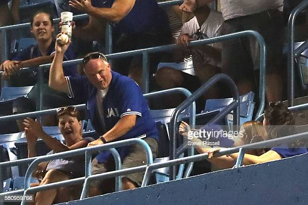 Fan comes up with San Diego Padres left fielder Alex Dickerson's two run homer into the fifth deck as the Toronto Blue Jays beat the San Diego Padres...
