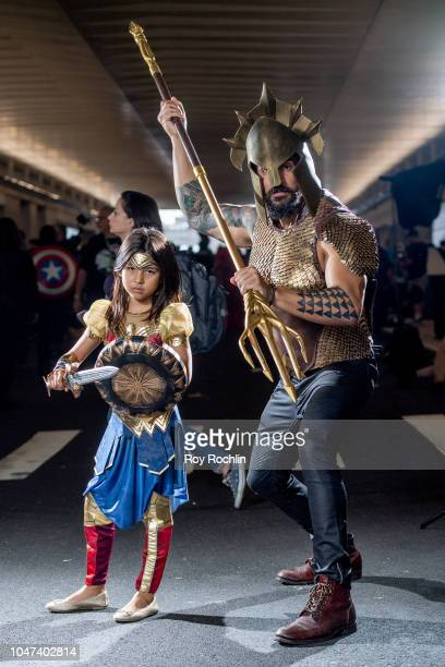 Fan cosplay as Wonder Woman and Aquaman form the DC Universe during the 2018 New York ComicCon at Javits Center on October 7 2018 in New York City