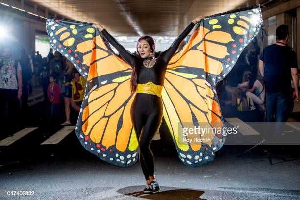 A fan cosplays as a Butterfly during the 2018 New York ComicCon at Javits Center on October 7 2018 in New York City