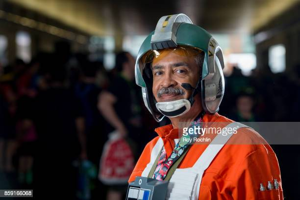 A fan cosplays as a Rebel XWing pilot from Starwars during 2017 New York Comic Con on October 8 2017 in New York City