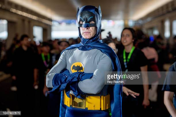 A fan cosplays as Adam West Batman form the DC Universe during the 2018 New York ComicCon at Javits Center on October 7 2018 in New York City