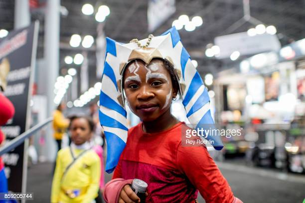 A fan cosplays as Ahsoka Tano from Starwars during the 2017 New York Comic Con Day 4 on October 8 2017 in New York City