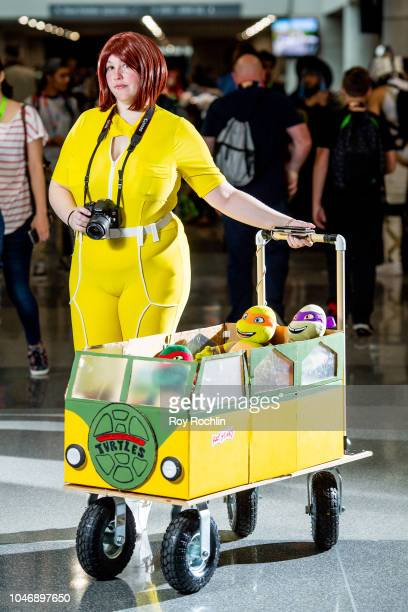 A fan cosplays as April O'Neil from Teenage Mutant Ninja Turtles during the 2018 New York Comic Con at Javits Center on October 6 2018 in New York...
