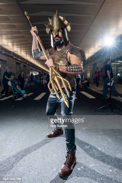 A fan cosplays as Aquaman form the DC Universe during the 2018 New York ComicCon at Javits Center on October 7 2018 in New York City