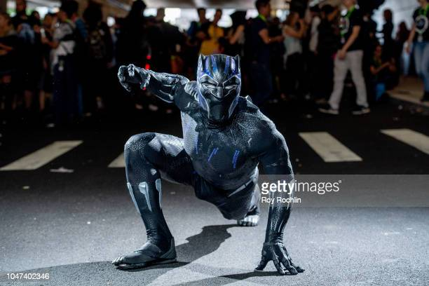 Fan cosplays as Black Panther from the Marvel Universe during the 2018 New York Comic-Con at Javits Center on October 7, 2018 in New York City.