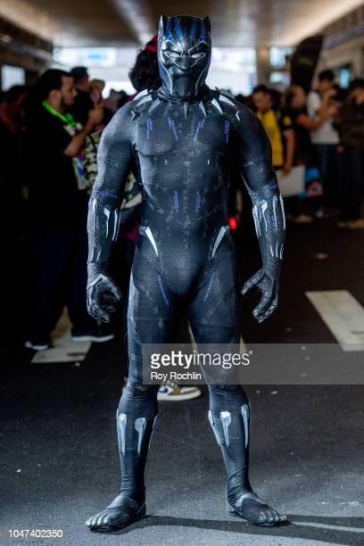 A fan cosplays as Black Panther from the Marvel Universe during the 2018 New York ComicCon at Javits Center on October 7 2018 in New York City