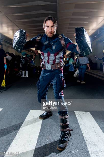 A fan cosplays as Captain America form the Marvel Universe during the 2018 New York Comic Con at Javits Center on October 5 2018 in New York City