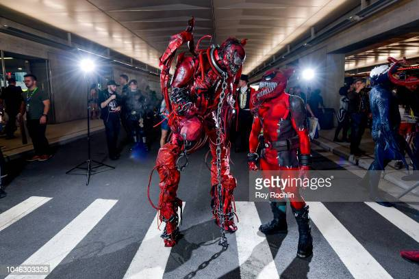 A fan cosplays as Carnage from SpiderMan and the Marvel Universe during the 2018 New York Comic Con at Javits Center on October 5 2018 in New York...