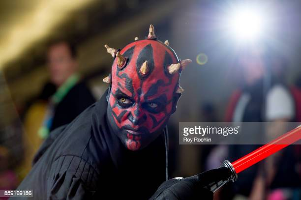 A fan cosplays as Darth Maul from Starwars during the 2017 New York Comic Con Day 4 on October 8 2017 in New York City