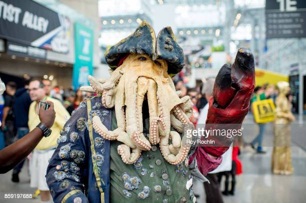 A fan cosplays as Davy Jones from Pirates of the Caribbean during the 2017 New York Comic Con Day 4 on October 8 2017 in New York City