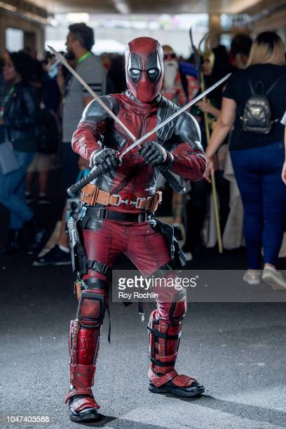 A fan cosplays as Deadpool from the Marvel Universe during the 2018 New York ComicCon at Javits Center on October 7 2018 in New York City