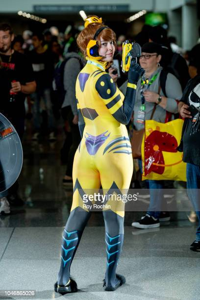 A fan cosplays as Diva from Overwatch during the 2018 New York Comic Con at Javits Center on October 6 2018 in New York City