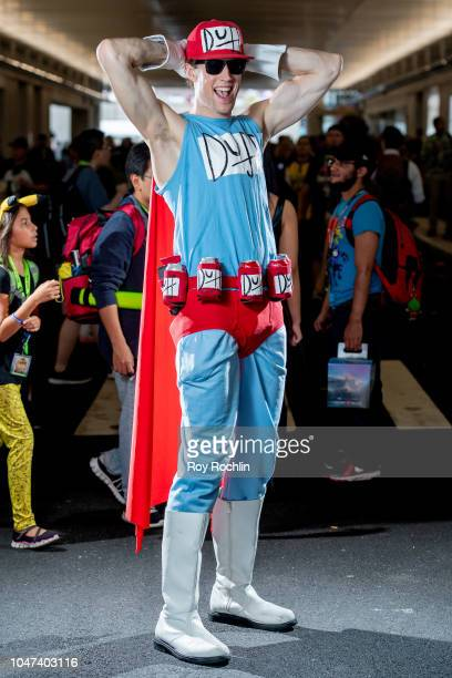 A fan cosplays as Duff Beer Guy form The Simpsons during the 2018 New York ComicCon at Javits Center on October 7 2018 in New York City