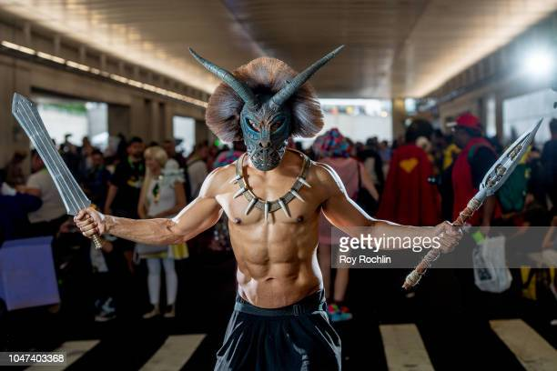 A fan cosplays as Erik Killmonger from Black Panther and the Marvel Universe during the 2018 New York ComicCon at Javits Center on October 7 2018 in...