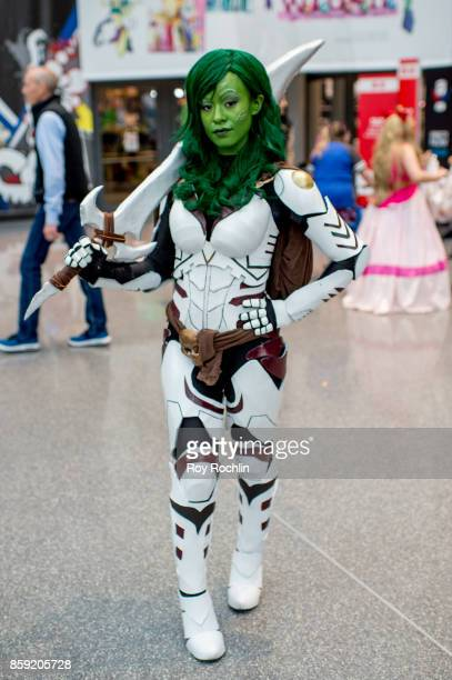 A fan cosplays as Gamora from Guardians of the Galaxy during the 2017 New York Comic Con Day 4 on October 8 2017 in New York City