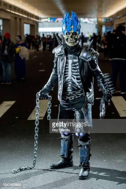 A fan cosplays as Ghost Rider form the DC Universe during the 2018 New York ComicCon at Javits Center on October 7 2018 in New York City